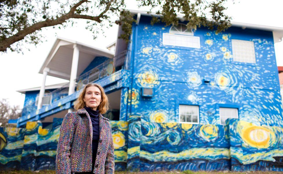 Nancy Nembhauser poses in front of the house with the Starry Night mural painted on it in Mount Dora, Florida, US, 29 January 2018