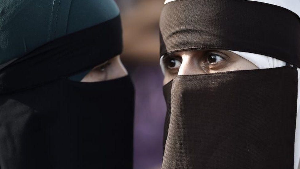 Women wearing a face veil