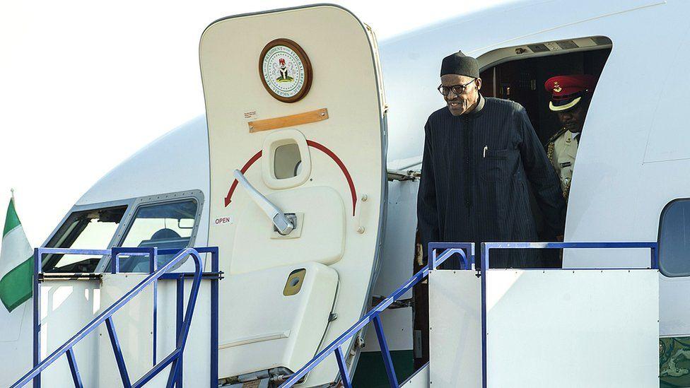 Nigerian President Muhammadu Buhari disembarks upon arrival at the Waterkloof Military air base in Pretoria, South Africa - 13 June 2015