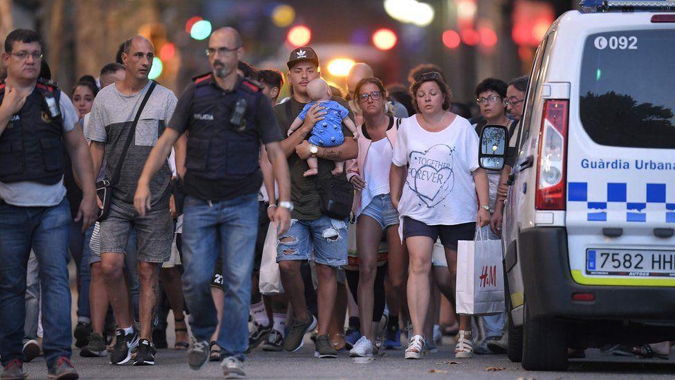 people leaving the scene of the van attack in Barcelona