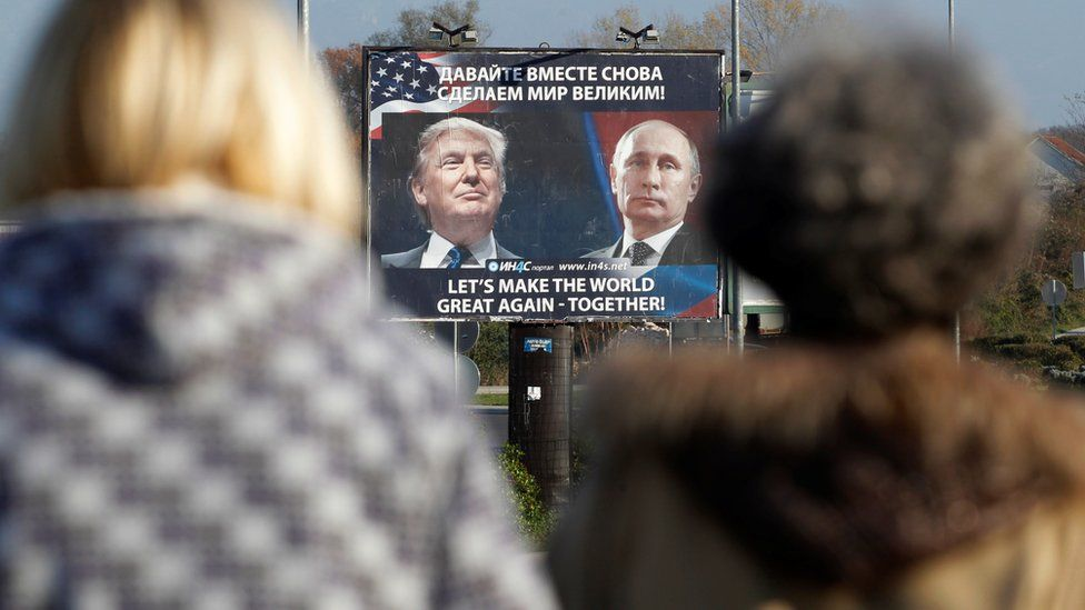 A billboard showing a pictures of US president-elect Donald Trump and Russian President Vladimir Putin is seen through pedestrians in Danilovgrad, Montenegro, 16 November 2016.