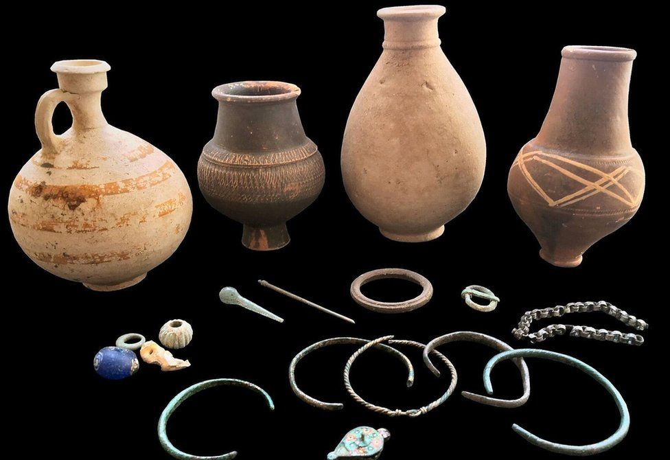4. A selection of grave goods from the cemetery include intact pottery vessels, glass and bone beads