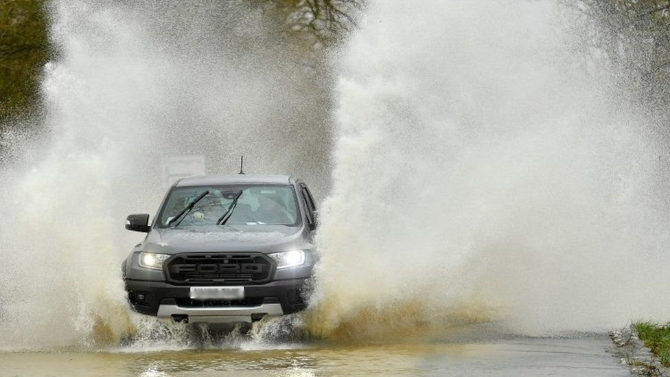Vehicle navigates flooded road in Leicestershire