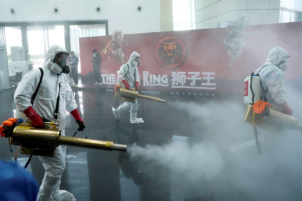 Volunteers disinfect the Qintai Grand Theatre in Wuhan