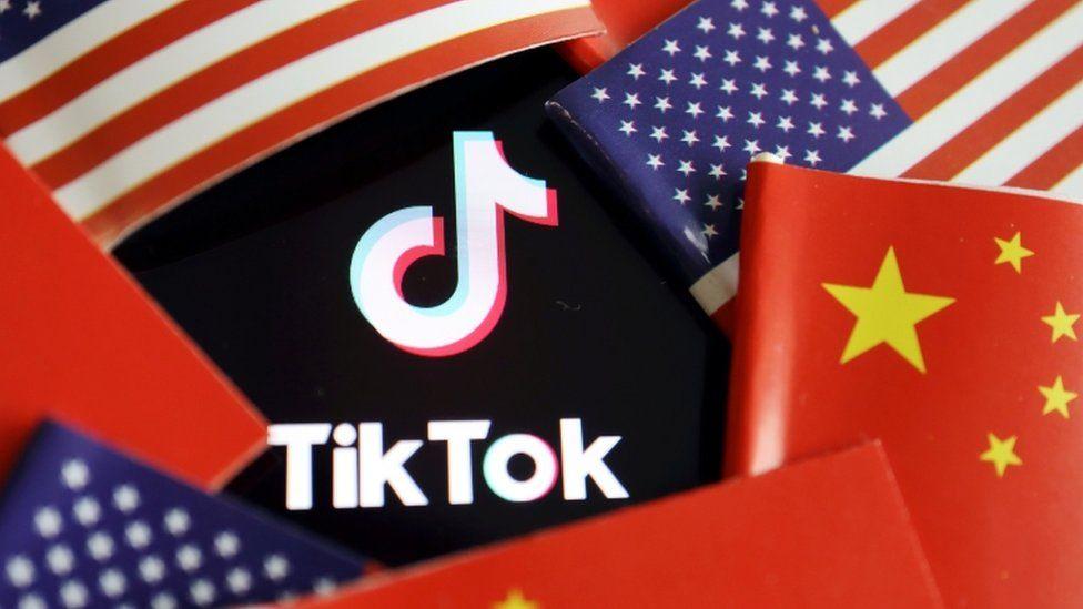 China and US flags around the TikTok logo.