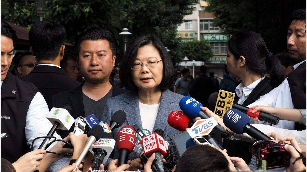 President Tsai Ing-wen speaks to reporters after casting her vote