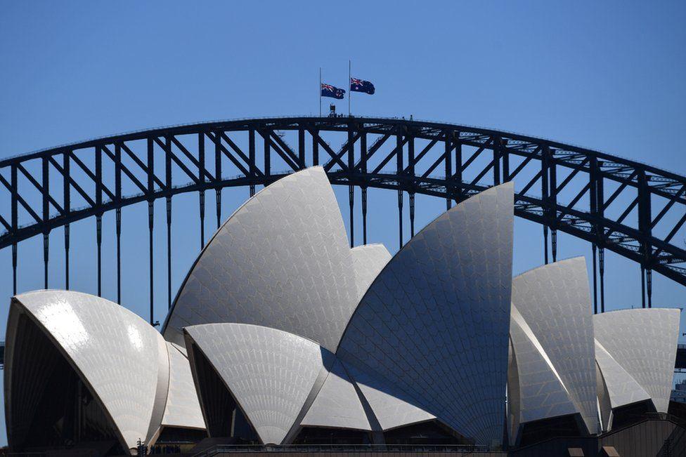 he Australian flag is seen half mast on the Sydney Harbour Bridge following the death of Prince Philip, Duke of Edinburgh, at Admiralty House, in Sydney, Australia, 10 April 2021.