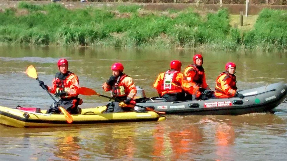 Firefighters in boats