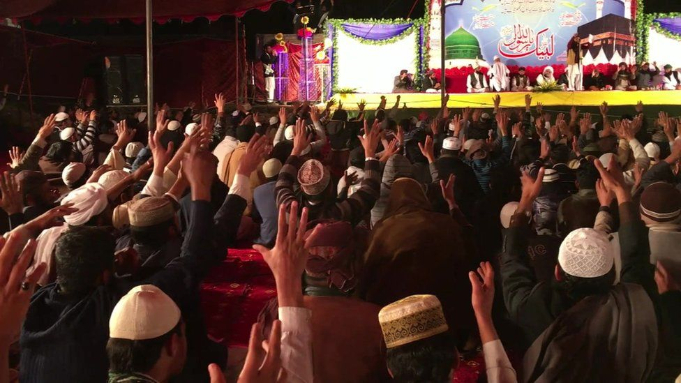 Supporters of Tanveer Ahmed chant slogans in Mirpur