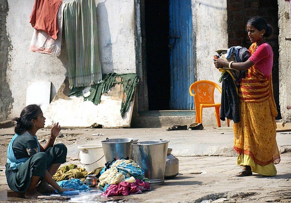 A woman washing clothes in India