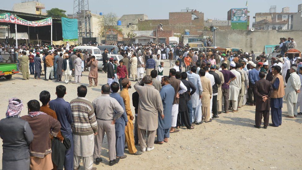 Pakistani supporters gather as the body of convicted murderer Mumtaz Qadri is brought to his house following his execution in Rawalpindi on February 29, 2016.