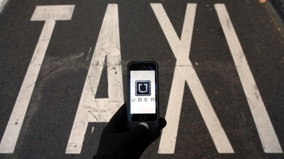 Taxi sign and Uber logo