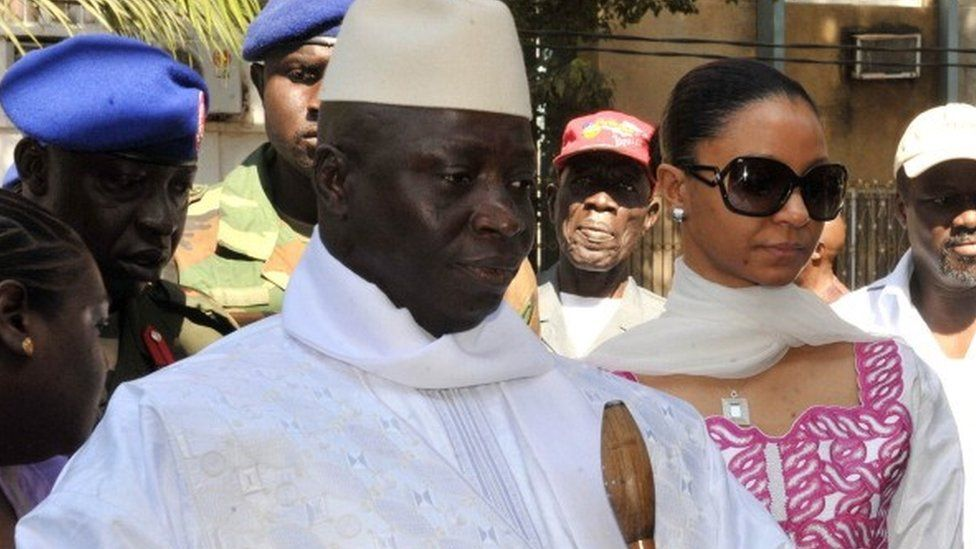 Gambian incumbent Yahya Jammeh (L) accompanied by his wife Zeineb Souma Jammeh (R) gets ready to vote on November 24, 2011 at a polling station in the capital Banjul