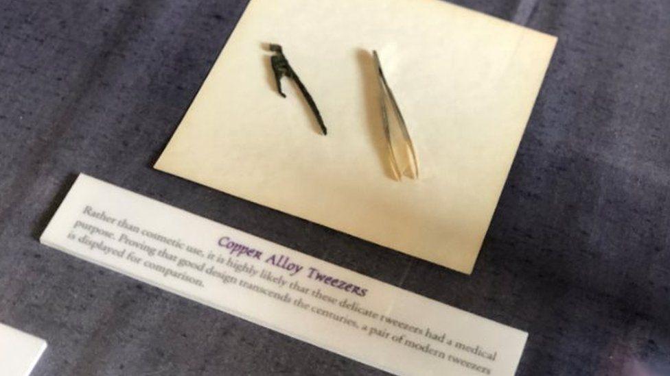 Copper alloy tweezers found in drain