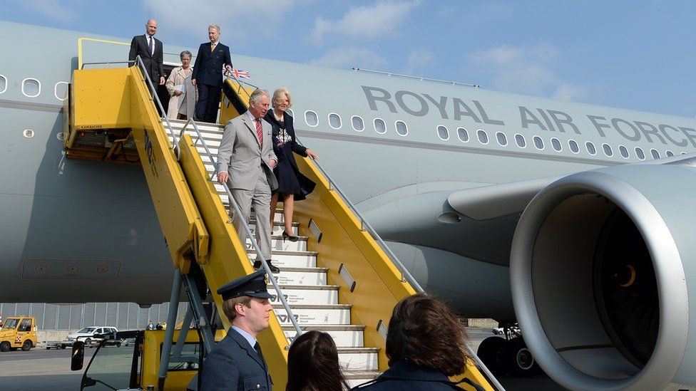 The Prince of Wales and Duchess of Cornwall leaving the plane.