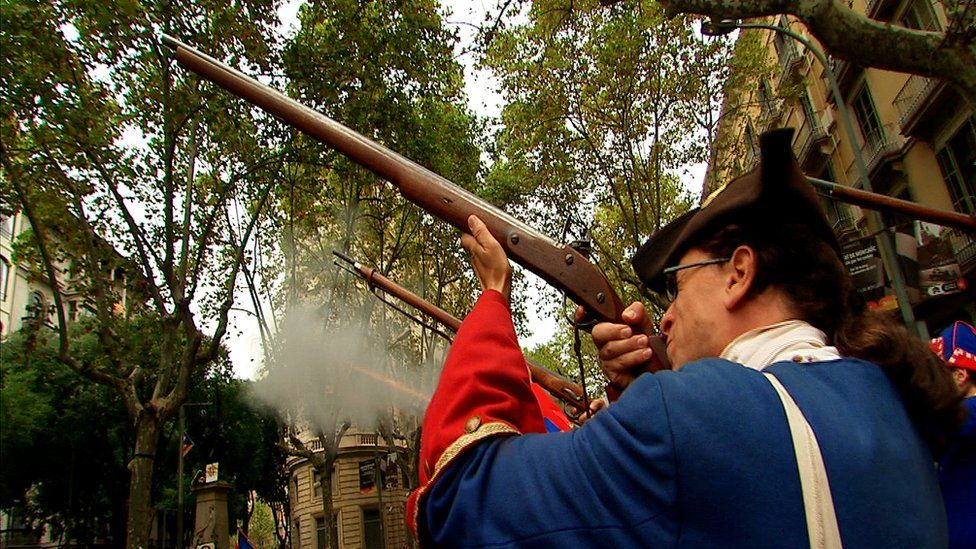 Man in historical costume fires rifle