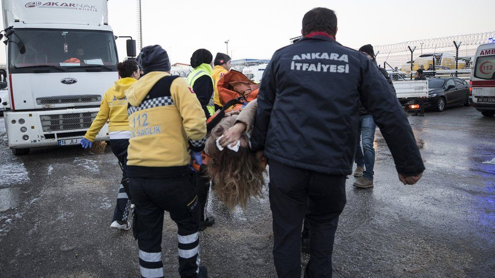Rescue workers evacuate injured passengers after crash
