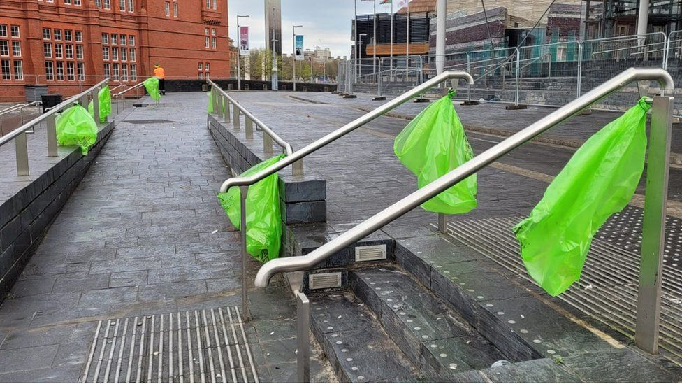 Empty bins in readiness for a new day outside the Senedd