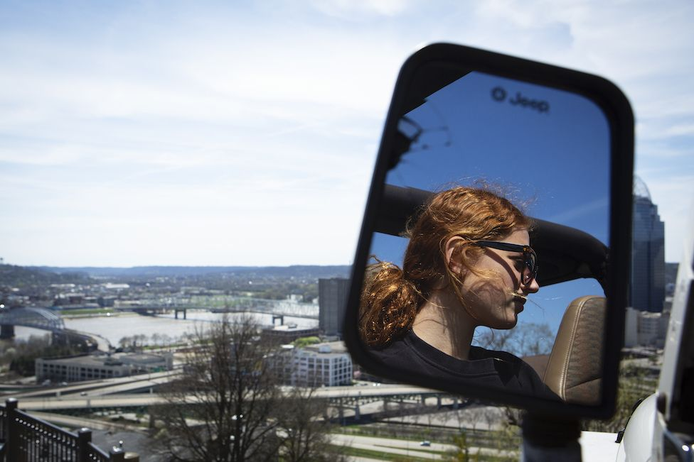 Maddie's sister Sabina's reflection in the car side mirror