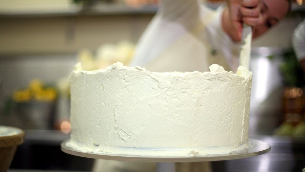 Claire Ptak puts finishes touches to the wedding cake