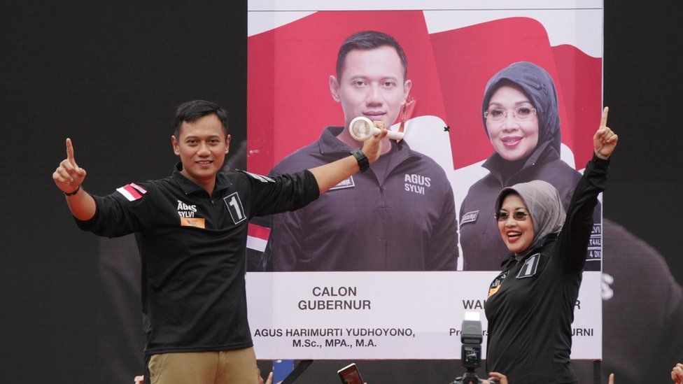 Agus Harimurti Yudhoyono (left) a candidate in the running to lead the Indonesian capital Jakarta, stands with his deputy Sylviana Murni during campaigning in Jakarta, Indonesia, February 11, 2017.