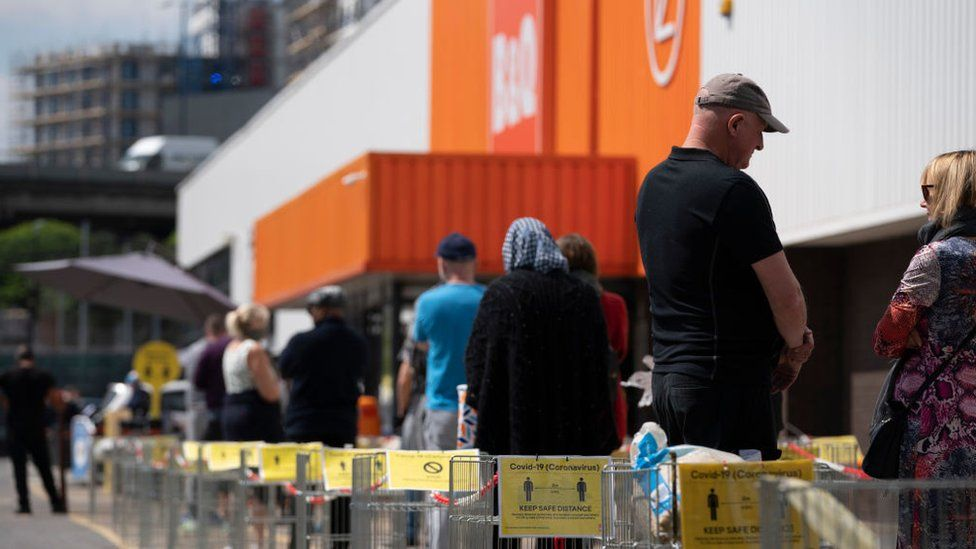 People queuing outside a B&Q store