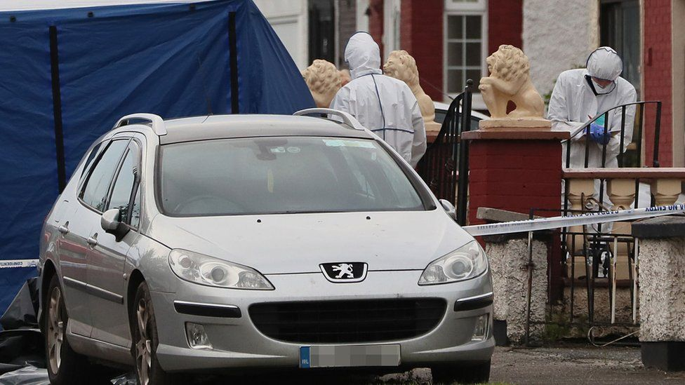 Gardaí in forensic suits at the scene of a shooting