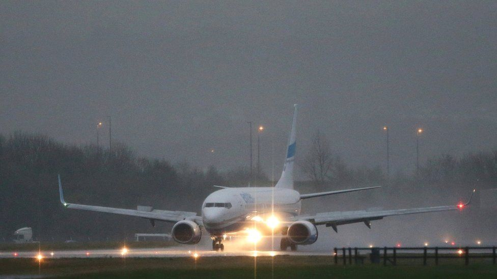 The plane carrying Syrian refugees lands at Glasgow airport