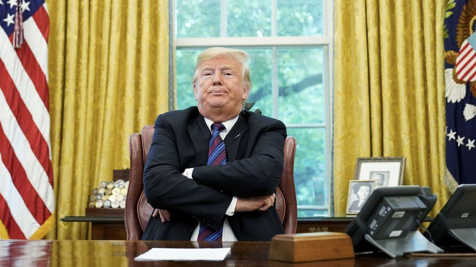 """In this file photo taken on August 27, 2018 US President Donald Trump speaks to reporters after a phone conversation with Mexico""""s President Enrique Pena Nieto on trade in the Oval Office of the White House in Washington, DC."""