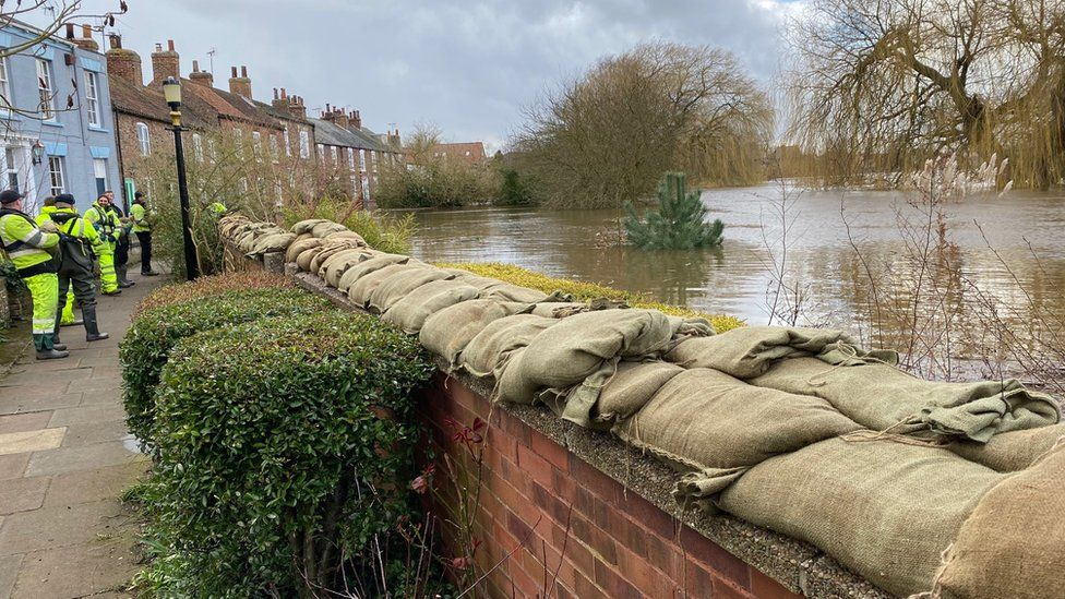 Sandbags on top of river defences in Cawood