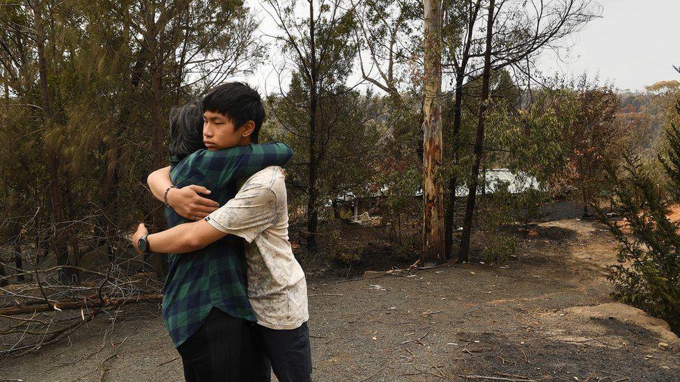 Gabriel Kam hugs his mother
