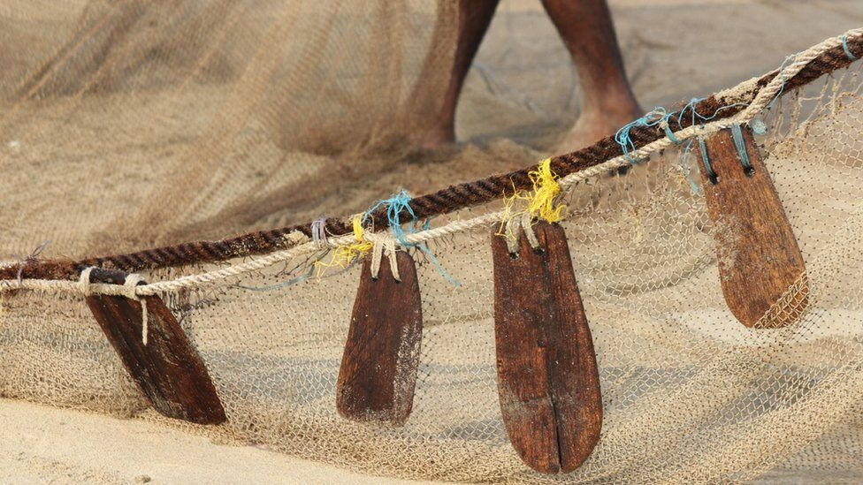 Handmade floats on a fishing net