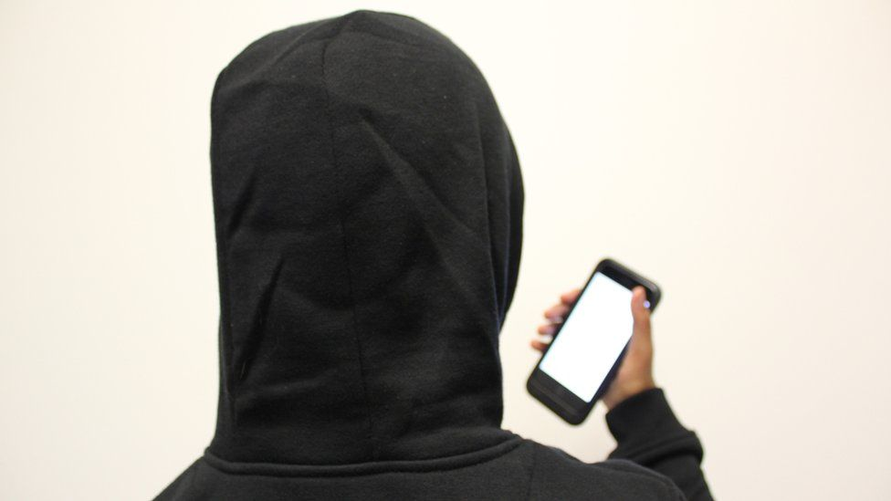 Anonymous person holding a phone