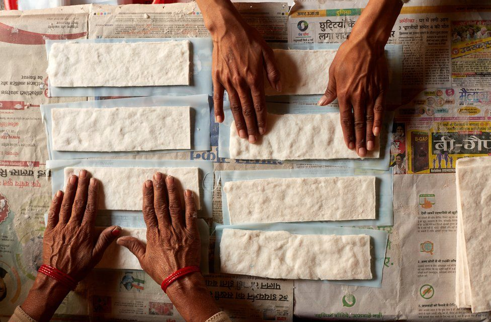 Women making sanitary pads