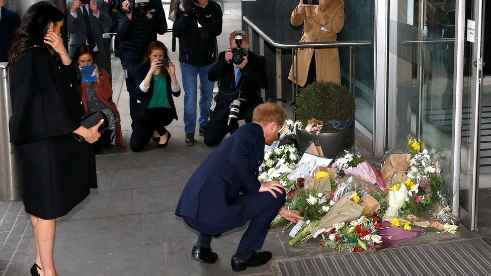 Prince Harry lays flowers outside the commission
