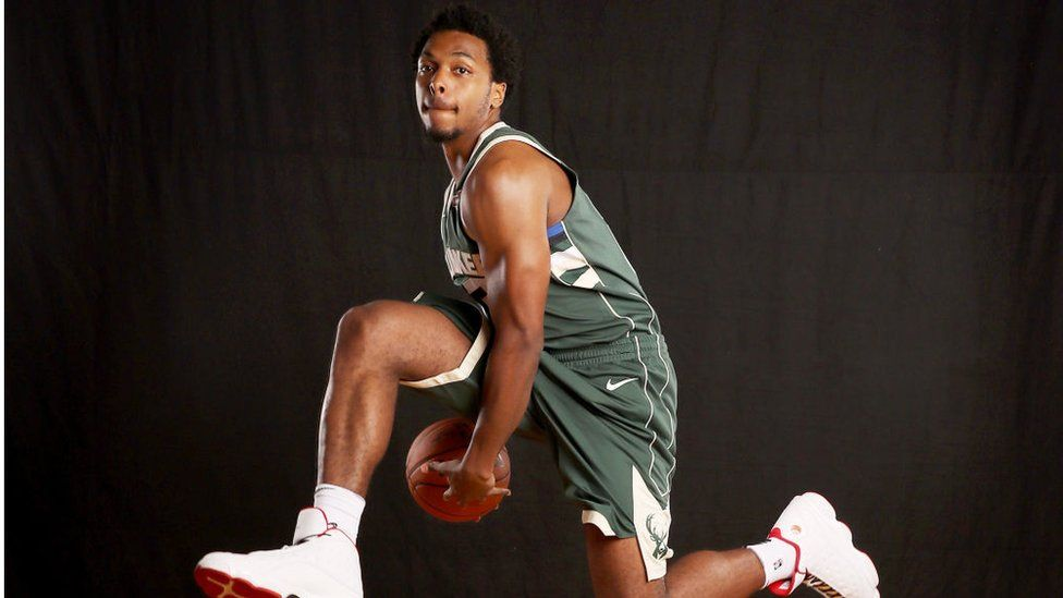 Sterling Brown poses for a promotional photo for his team, the Miwaukee Bucks