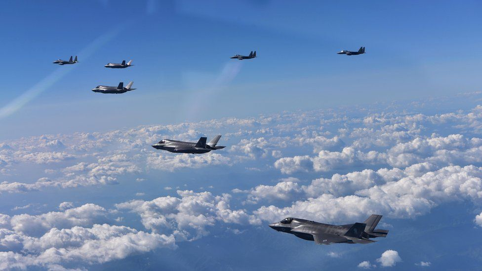 In this handout image provide by South Korean Defence Ministry, South Korea's F-15K fighter jets and US marine's F-35B fly over the Korean Peninsula during a training on 31 August 2017 in Gangwon-do, South Korea