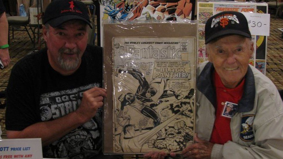 Joe Sinnott (right) and his son Mark holding the original unused cover of Fantastic Four #52, the first appearance of The Black Panther at Albany Comic Con, 2016
