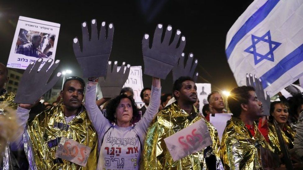 African asylum seekers and Israelis protesting against the African asylum seekers deportation, as thousands take part in a demonstration in Rabin square, Tel Aviv, Israel, 24 March 2018.