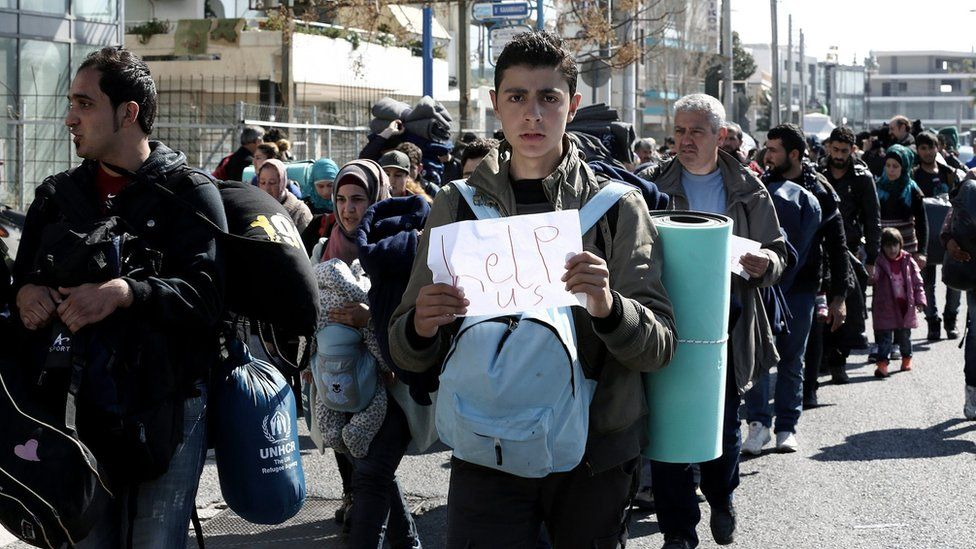 Migrants and refugees leave the old airport, used as a temporary hosting shelter, and walk on the seaside avenue in Athens, Greece, 26 February 2016, trying to reach the railway station.