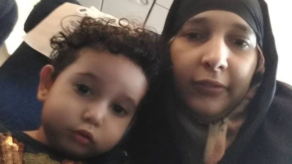 Safia Saleh and her two-year-old Asalah on the plane from Yemen