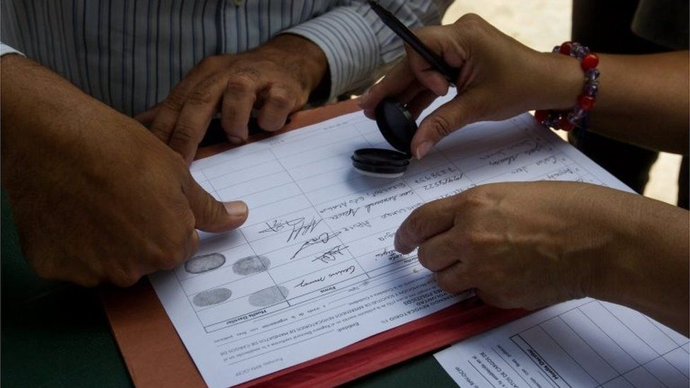 A group of people participates in the signature collecting as part of the process to seek a referendum to remove President of Venezuela, Nicolas Maduro, in Caracas, Venezuela, 28 April 2016
