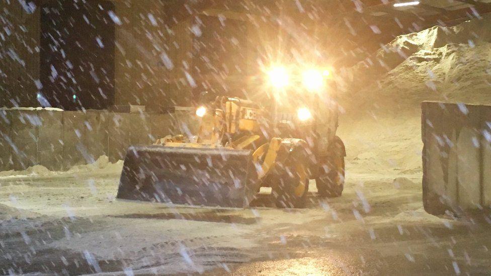 Snow falling at roads depot