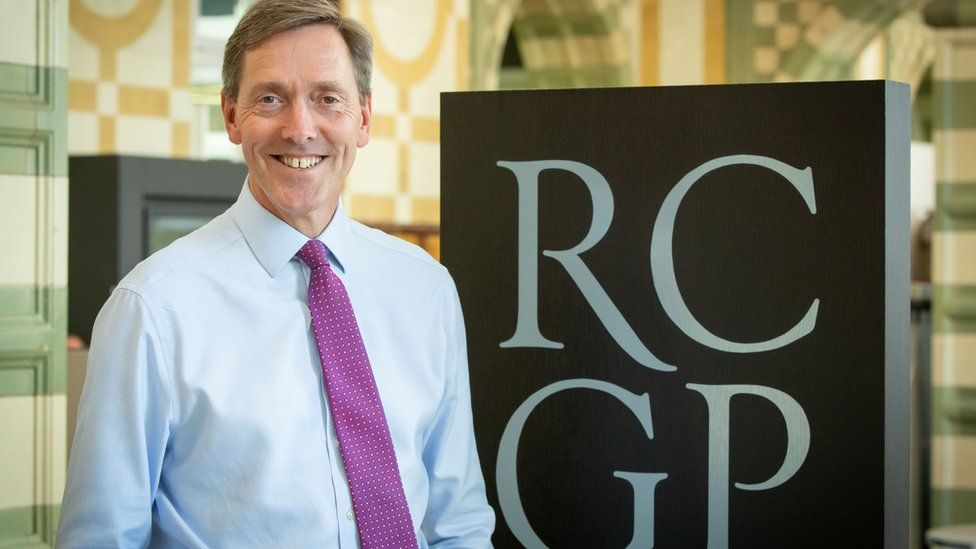 Prof Martin Marshall stands next to a logo for the Royal College of GPs