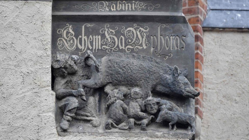 A medieval anti-Semitic carving depicting Jews suckling the teats of a sow as a rabbi looks intently under its leg and tail is pictured at the Stadtkirche (Town and Parish Church of St Mary's) in Wittenberg, eastern Germany.