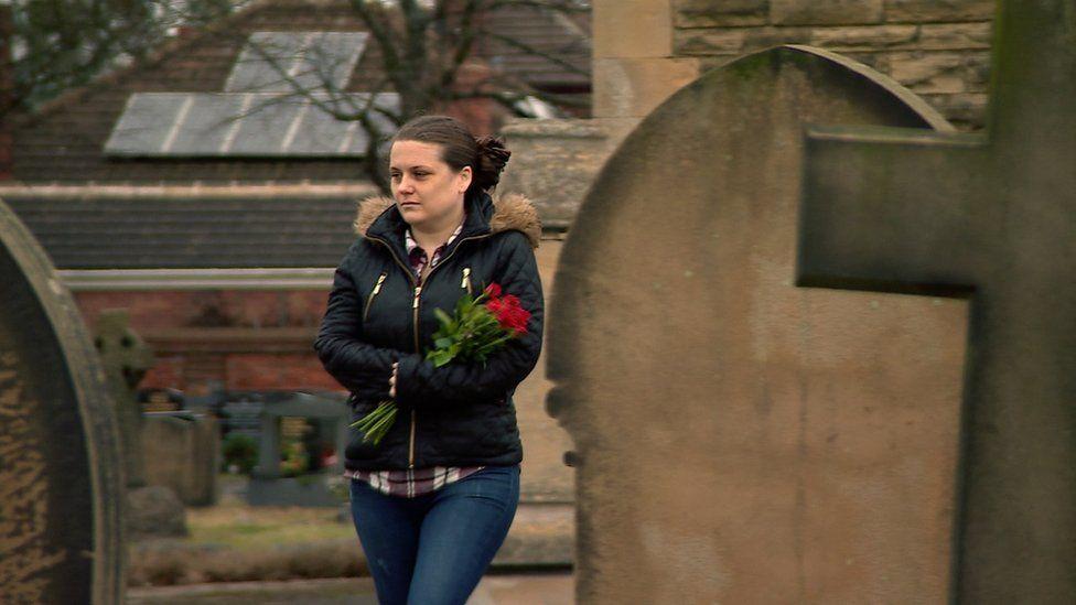 Charlotte Butcher visiting her husband's grave