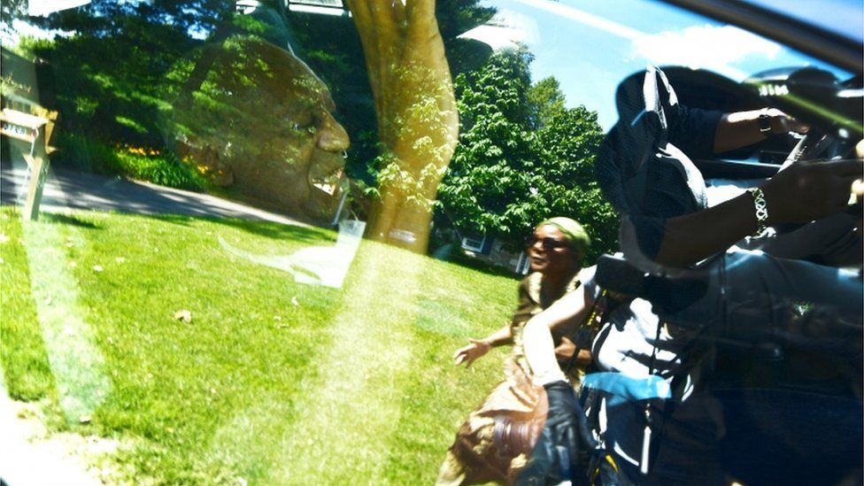 Bill Cosby sitting in a car
