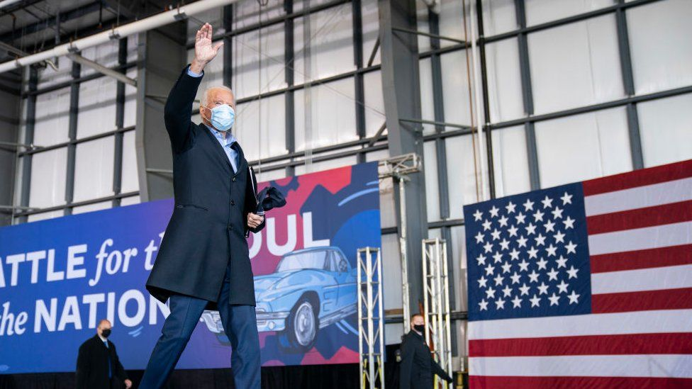 Mr Biden made a last-minute campaign stop for a drive-in rally in Ohio