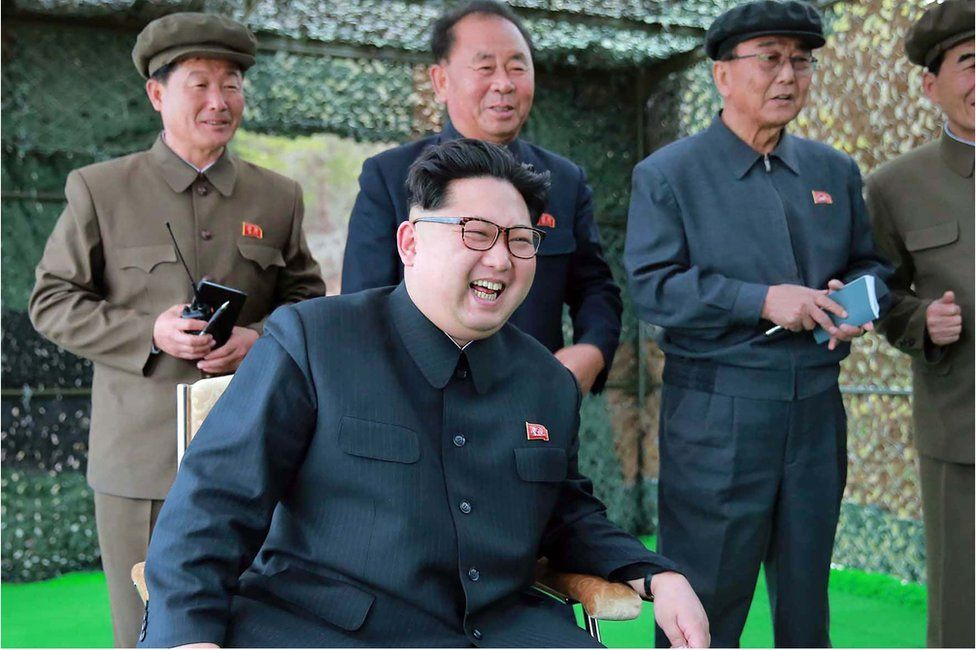 This picture released from North Korea's official Korean Central News Agency (KCNA) on 24 April 2016 shows North Korean leader Kim Jong-Un (R) during the inspection of an underwater test-fire of a strategic submarine ballistic missile at an undisclosed location in North Korea on 23 April 2016