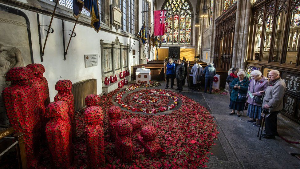 People look at an installation titled Coming Home by artist Martin Waters at Hull Minster.